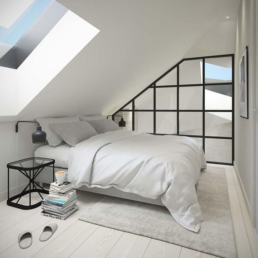 Myynnissä olevan ullakkoasunnon upea makuuhuone ruutulasiseinällä